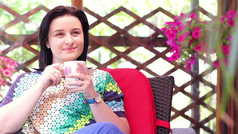 Woman enjoying her morning coffee outdoors Footage