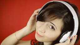Music woman red headphones glance copyspace GIF