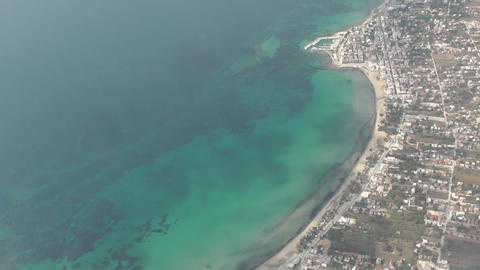 aerial view of Greek sea, coast and seaside town landscape Live Action