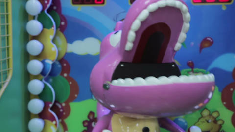 Arcade game machine at an amusement park, purple dragon Footage