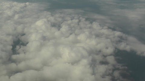 4 video clips of clouds and aerial views in 1 video Footage