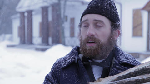 Russian bearded man dressed in 19th century against the background of the winter Footage