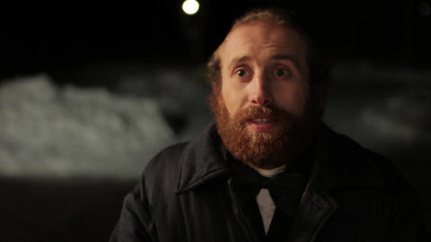 bearded man in a suit and bow tie on a background of winter, night Footage