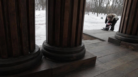 Bearded Russian costume in the 19th century, shines shoes on the porch of an old Footage