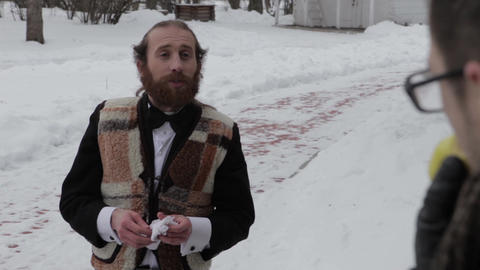 bearded man in a suit and bow tie on a background of winter Footage