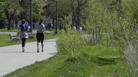 Girlfriends jogging in the park. 4K UHD Footage