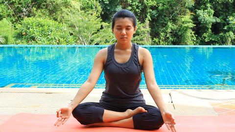 Young Asian Woman Doing Yoga stock footage