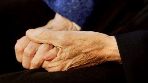 Old Couple Holding Hands stock footage