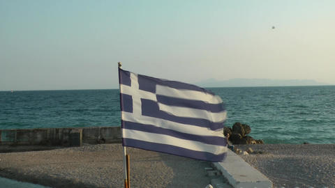 Greek Flag Next To The Sea stock footage
