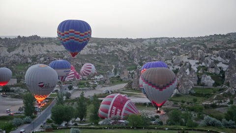 Balloons prepare for take-off before sunrise Live Action