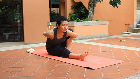 Asian woman doing yoga Footage