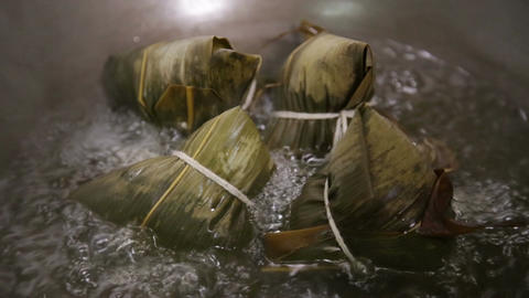 Zongzi Boiling In A Wok stock footage