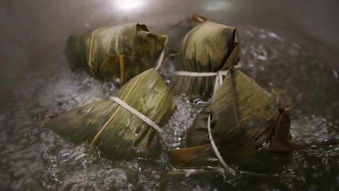 zongzi boiling in a wok Footage