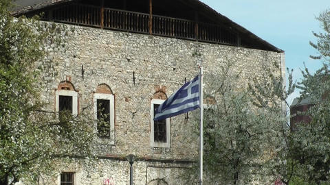 Greek Flag Waves In Front Of A Building stock footage