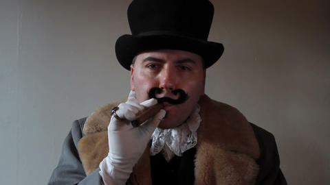 Capitalist smokes a cigar Footage