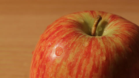 Sliding macro view of an apple Footage