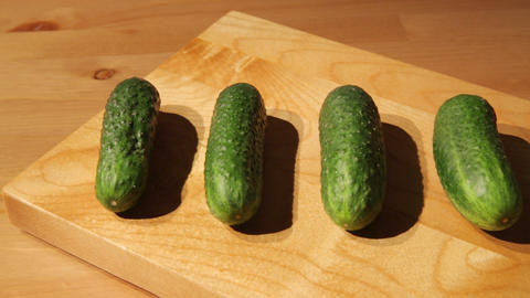 Fresh cucumbers on a board Footage