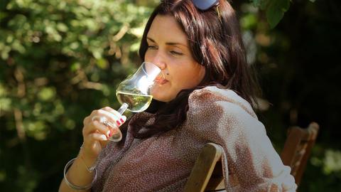 Drinking wine in garden Footage