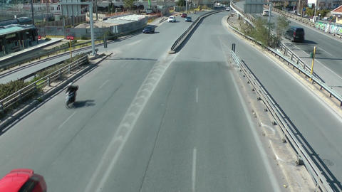 Cars and motorcycles on a highway road with high speed Footage