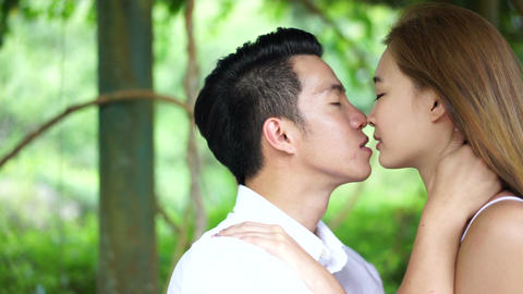 Asian couple kissing dolly motion Footage