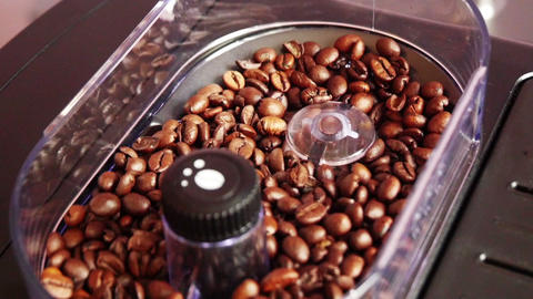 Milling Of Roasted Coffee Beans In Grinder stock footage