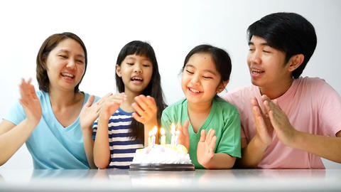 Slow Motion Happy Moment Of Asian Family Blowing Birthday Candles stock footage
