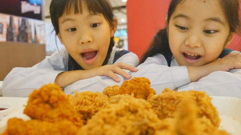 Slow Motion Of Happy Asian Girls With Fried Chicken In Restaurant, Zoom In Camer stock footage