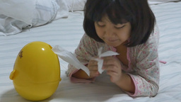 Little Asian child sick with flu sneezing and clean with tissue paper Footage