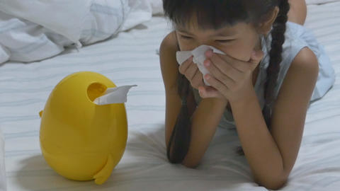 Little Asian Child Sick With Flu Sneezing And Clean With Tissue Paper stock footage