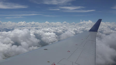 Airplane Wing Flying Through Fluffy Clouds Footage
