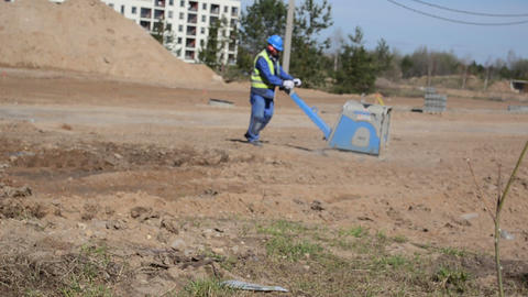 worker in blue workwear at construction site Footage