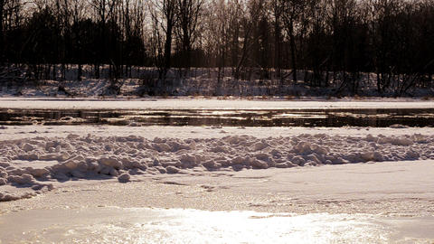 frozen neris river in winter and floe floating sun reflections Footage