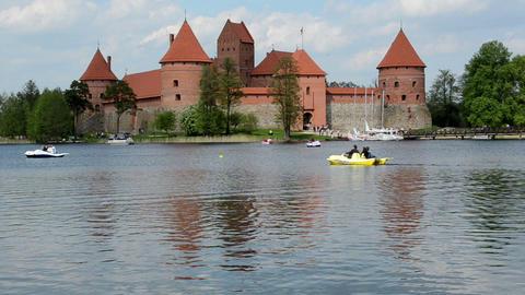 people recreate water transport bicycle on lake in trakai Footage