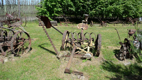 vintage agricultural rusty tools collection wooden fence Footage