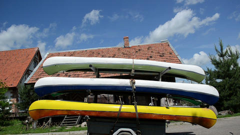 kayaks canoes boats loaded on special transport trailer Footage