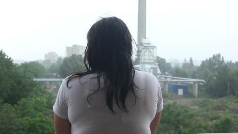 women in the rain back view Live Action
