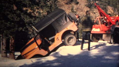 (8mm Vintage) 1968 Jeep Stuck in Hole Rescued by Tow Truck Footage