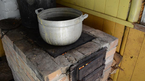 huge dirty pot stand rural kitchen stove furnace firewood burn Footage