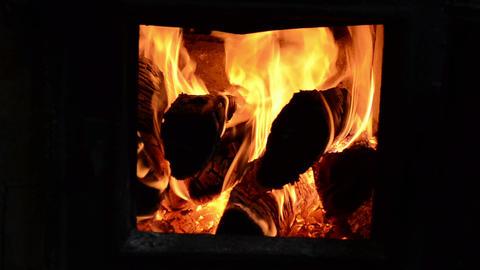 closeup burn firewood wood flame rural stove furnace Footage