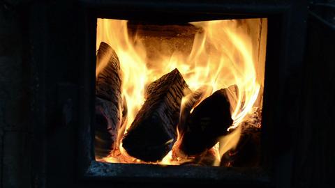 closeup detail burn firewood wood flame rural stove furnace Footage