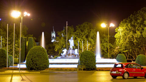 Neptune Fountain (Fuente de Neptuno) at night. Madrid, Spain. Timelapse Footage
