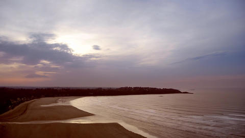 Time-lapse scenery of a bay in evening during the tide - Waves and clouds Footage