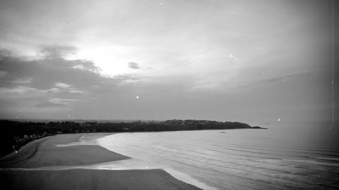 Waves And Clouds. Old Movie Effects With Scratches And Flickering. B + W stock footage