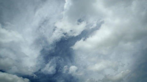Timelapse of nice white clouds on a sunny blue sky moving in different direction Footage