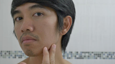 Asian man checking a skin problem on his face Footage