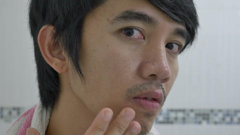 Asian Man Checking A Skin Problem On His Face stock footage