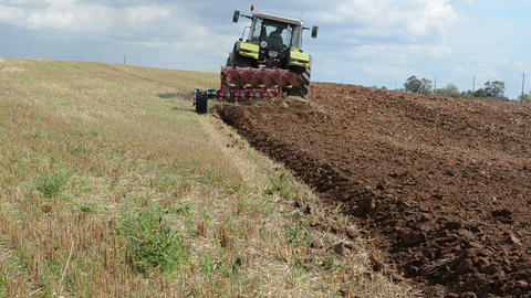 heavy agriculture machine tractor plow field Footage