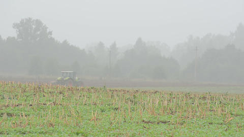 autumn morning fog agriculture works tractor plow field Live Action