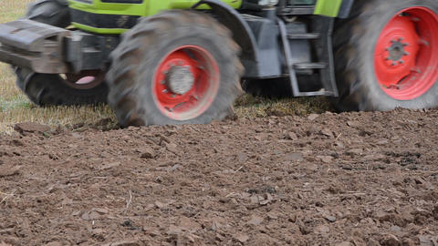 tractor closeup pass plowing agricultural field in autumn Footage