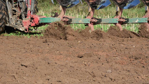 closeup heavy agriculture machinery plough field soil Footage